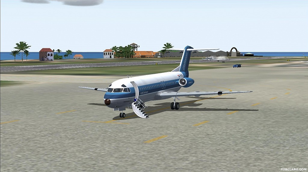 Project Fokker F-28 at Princess Juliana with Lear arriving in background. - Photo 17824