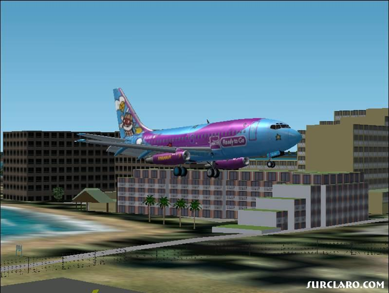 Ryanair 737-200 arriving in Juliana! It is a beautiful place and it deserved a colourful livory.   - Photo 16313