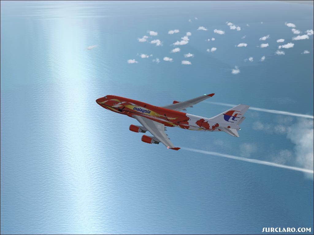 747-400 Malaysia Aitlines flying over the sea with nice water reflections in the background. - Photo 7915