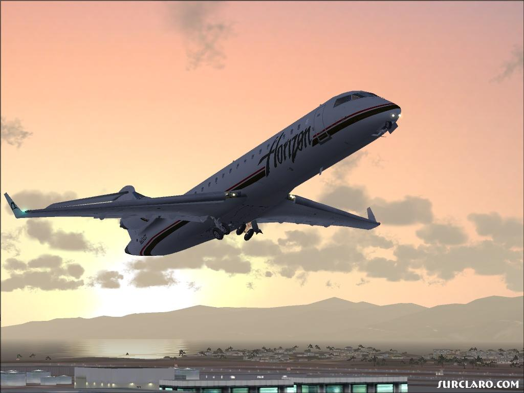 Departing KLAX on one of those days when the wind doesn't blow from the ocean. - Photo 11516
