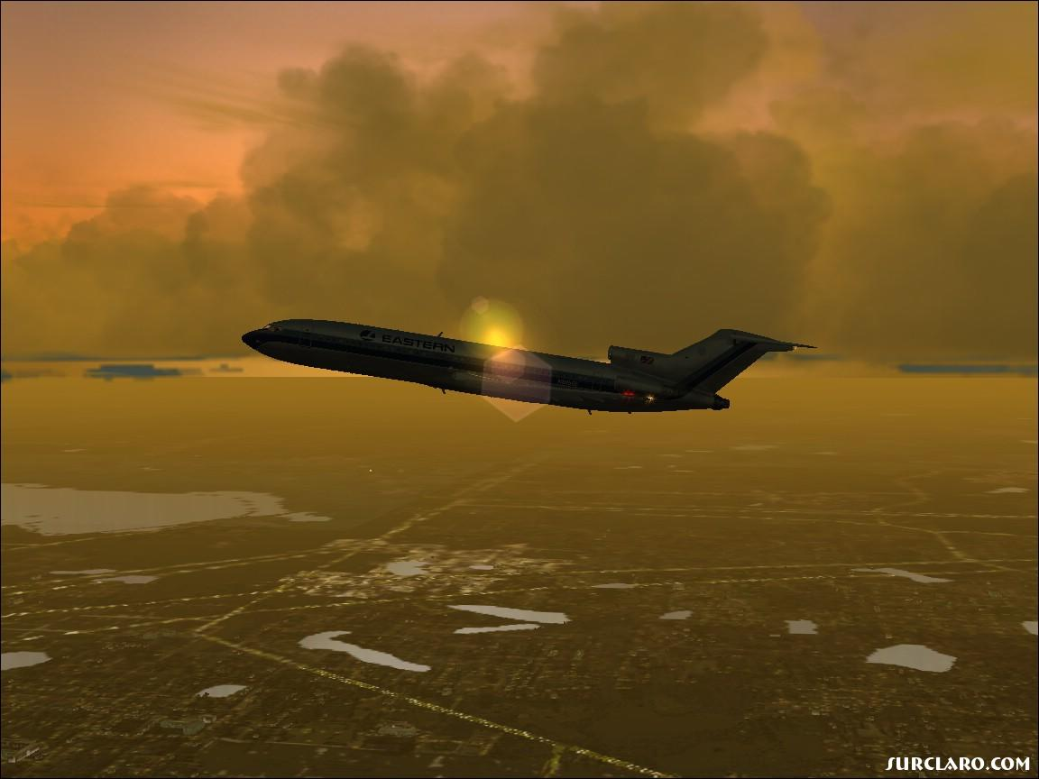 727 climbing out of 'freeflow' orlando at dusk. - Photo 11620