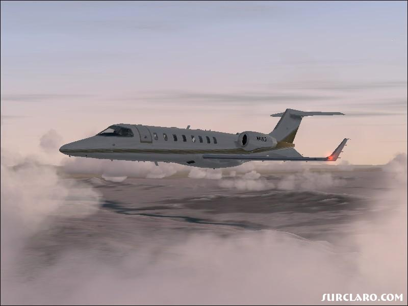 Learjet 45 Flying Through Colorado. - Photo 7955