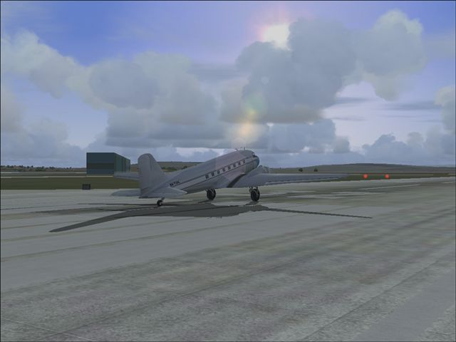 douglas about to take off in swiss, this is not an edit pic the sun and the clouds are really like this in fs 2004!! - Photo 3088