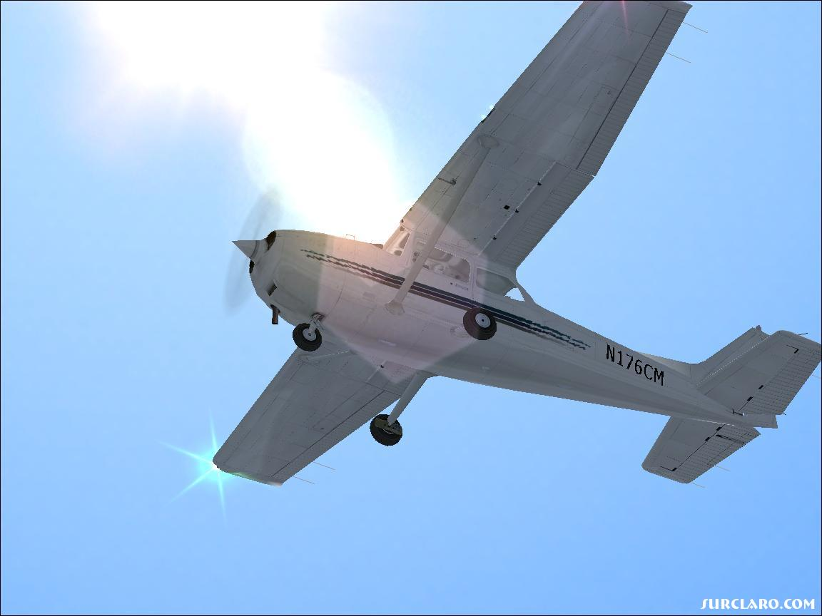 A nice shot of my Cessna 172 cruiding away with a cool camera affect with the sun - Photo 11186
