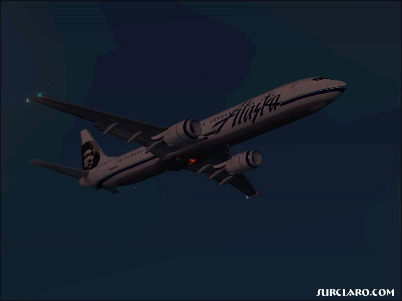 Alaska Airlines flying at night over L.A. - Photo 2729