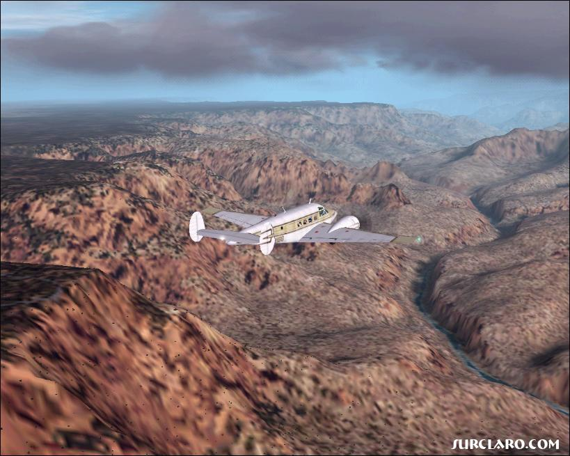 Beechcraft G-18-S over the Grand Canyon Arizona with the Colorado River running at the bottom - Photo 2820