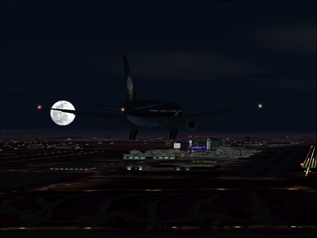 An approach on runway 7L at KLAX on a beautiful full moon evening. - Photo 1757