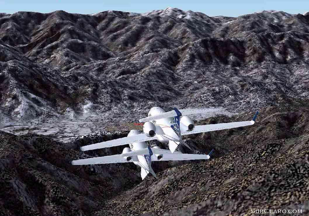 Dueling Lear Jets (networked) over some mountains in Japan. (2004) - Photo 3540