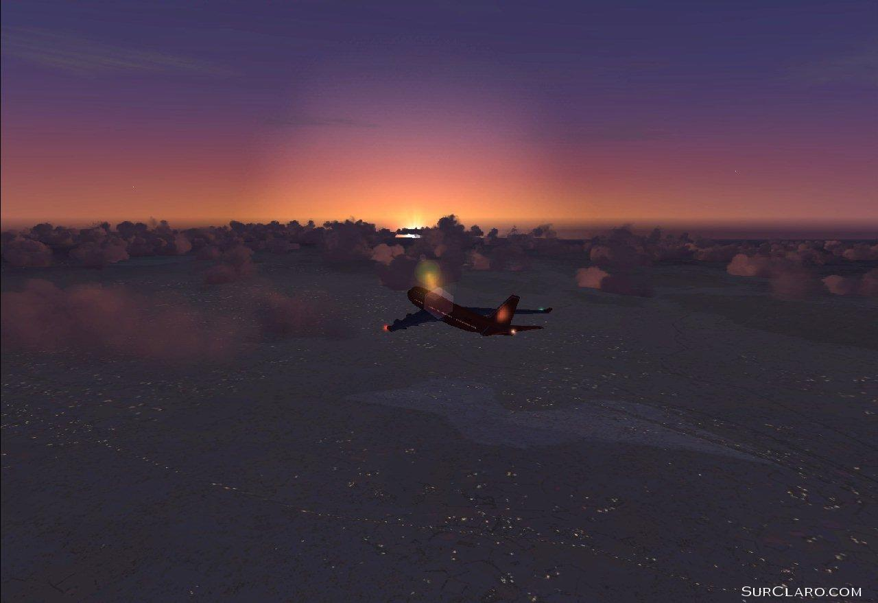 Shot #1 of a 747 heading towards Lake Geneva, Switzerland at dusk (FS2004) - Photo 3544