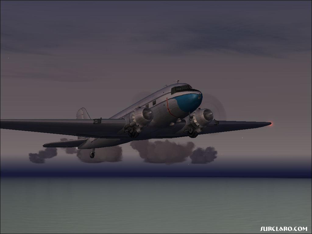 A DC-3 flying at sunset. Beautiful! - Photo 3471