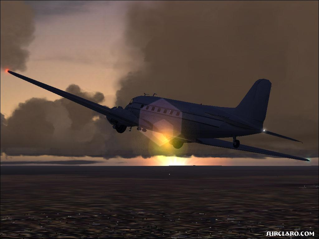 A DC-3 flying at sunset. Beautiful! - Photo 3472