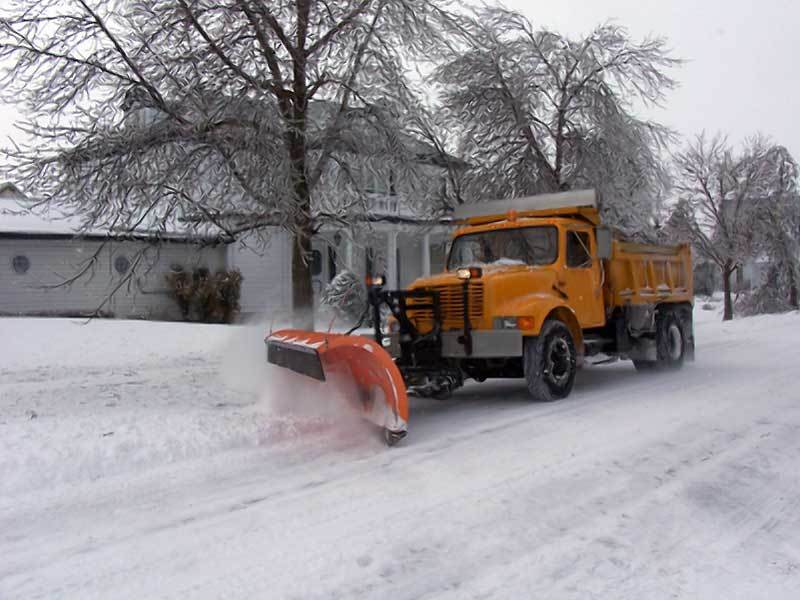 puts down salt plow moves side to side up and down and actually plows the snow off the ground - Photo 16765
