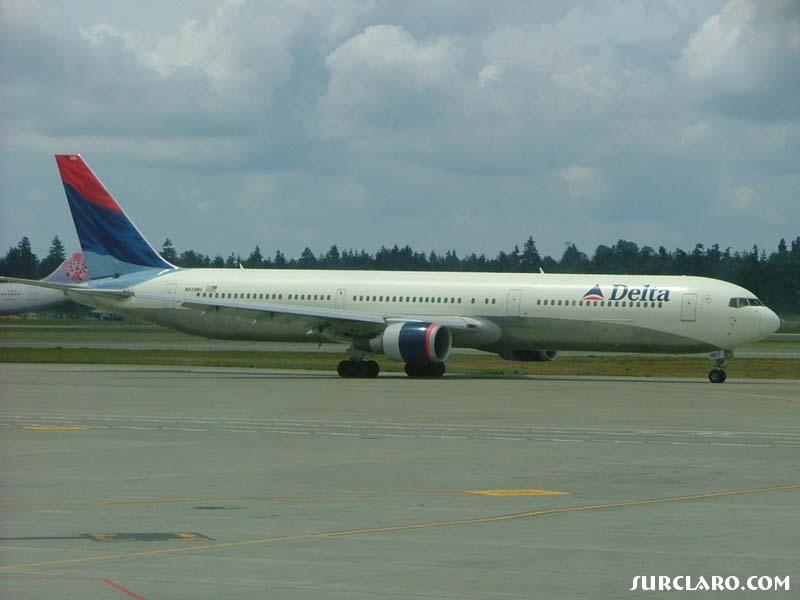 I snapped this shot of Delta 767-400, a regular visitor here in Seattle, WA.  An A340 China Airlines Tail is also in the shot ;) Thanks. - Photo 8585